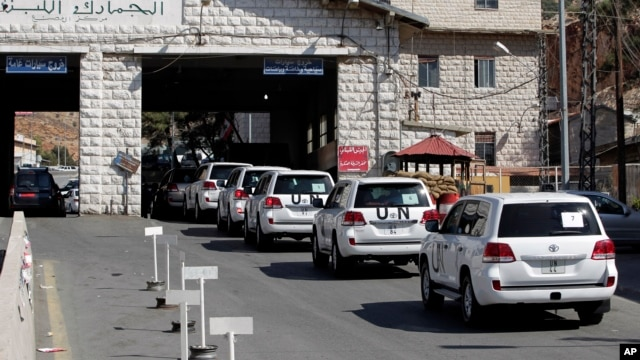 FILE - A convoy of inspectors from the Organization for the Prohibition of Chemical Weapons prepares cross into Syria at the Lebanese border crossing point of Masnaa, Oct. 1, 2013.