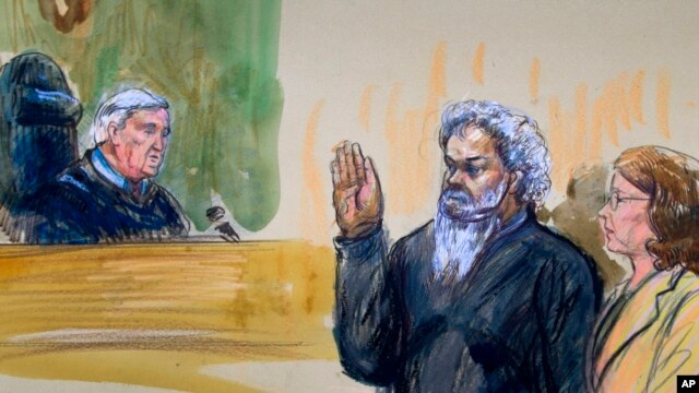 This artist's rendering shows United States Magistrate, Judge John Facciola, swearing in Libyan militant Ahmed Abu Khatallah, as his attorney looks on during a hearing at the federal U.S. District Court.