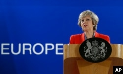 FILE - British Prime Minister Theresa May answers a question from the media.