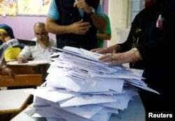 Lebanese election officials count ballots after the polling station closed during Lebanon's parliamentary election, in Beirut, Lebanon, May 6, 2018.