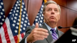 FILE - Sen. Lindsey Graham, R-S.C., speaks during a news conference on Capitol Hill, Dec. 6, 2017, in Washington.