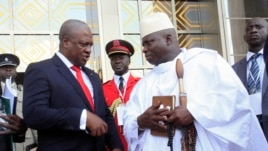 Ghana's President John Dramani Mahama (L) speaks with Gambia's President Yahya Jammeh (R) after a West African regional bloc ECOWAS summit on the crisis in Mali and Guinea Bissau, in Yamoussoukro, Ivory Coast, February 27, 2013.