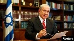 Israeli Prime Minister Benjamin Netanyahu gestures as he speaks, in Jerusalem, June 2013.