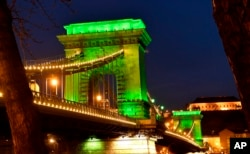 The Chain Bridge is illuminated in green in honor of St. Patrick's Day in Budapest, Hungary, Friday, March 17, 2017. (Tibor Illyes/MTI via AP)