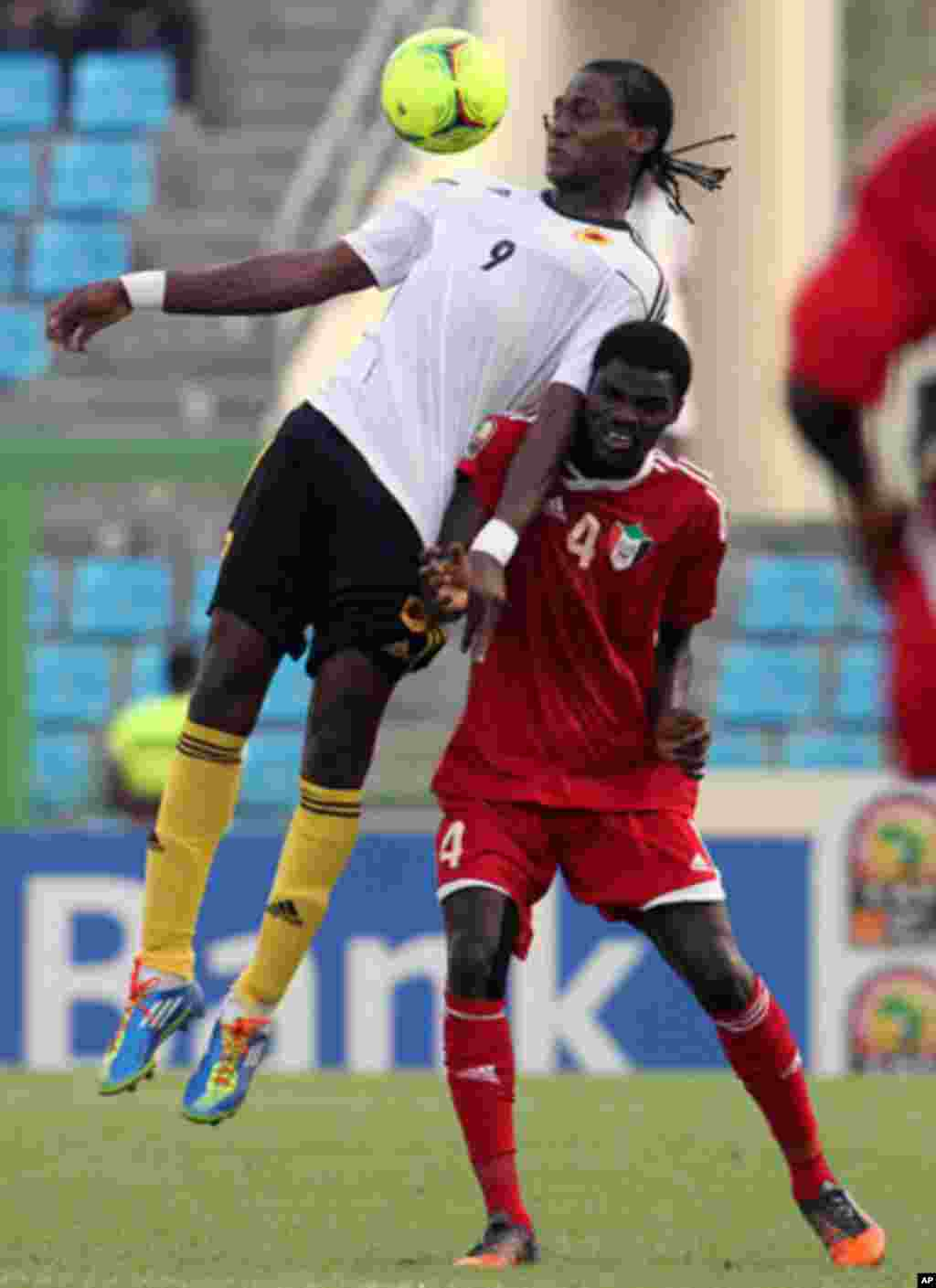 Manucho of Angola fights for the ball with Nagm Eldim of Sudan during their African Nations Cup soccer match in Malabo