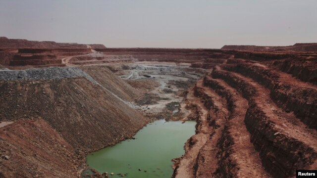 The Tamgak open air uranium mine is seen at Areva's Somair uranium mining facility in Arlit, Niger, September 25, 2013.