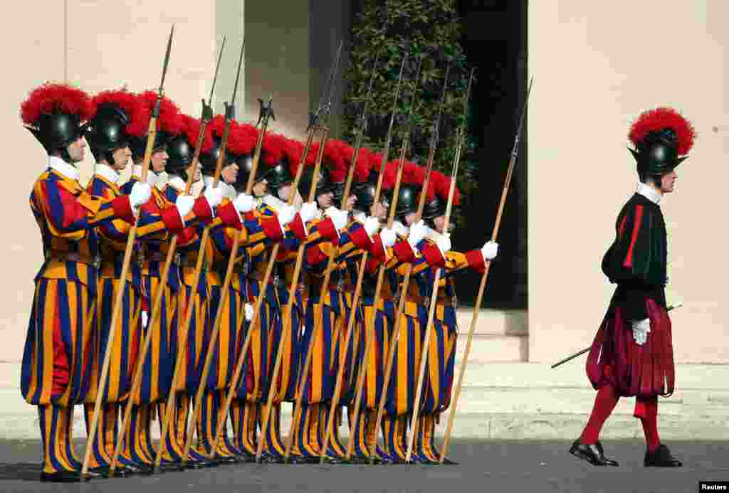 Swiss Guards stand at attention prior to the arrival of Lebanese President Michel Aoun for a meeting with Pope Francis at the Vatican.
