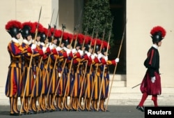 FILE - Swiss Guards stand at attention prior to Lebanon's President Michel Aoun arrival to meet with Pope Francis at the Vatican March 16, 2017.