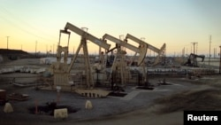 FILE - Oil pumpjacks owned by Occidental Petroleum Corp. operate near Long Beach, California, July 30, 2013.