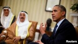 Presiden AS Barack Obama bertemu Emir Kuwait, Sheikh Sabah al-Ahmad al-Jaber al-Sabah, di Gedung Putih (13/9). (Reuters/Jason Reed)