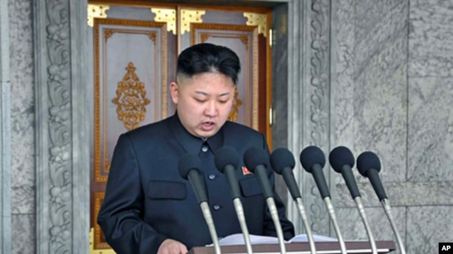 North Korean leader Kim Jong Un delivers a speech during a mass military parade in Kim Il Sung Square, April 15, 2012.