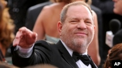 FILE- In this Feb. 22, 2015 file photo, Harvey Weinstein arrives at the Oscars at the Dolby Theatre in Los Angeles.