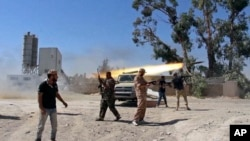 In this July 26, 2014 frame grab from video obtained from a freelance journalist traveling with the Misrata brigade, Islamist Misrata brigade fighters fire towards Tripoli airport in an attempt to wrest control from a powerful rival militia, in Tripoli, Libya.