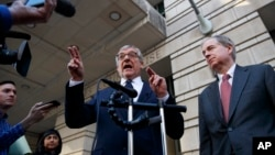 Attorney Paul Kamenar, left, speaks to the media after presenting arguments in federal court about special counsel Robert Mueller's appointment to lead the Russia investigation, in Washington, Nov. 8, 2018.