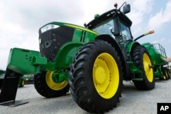 FILE - John Deere equipment is on display at the Farm Progress Show in Decatur, Ill., Aug. 31, 2015.
