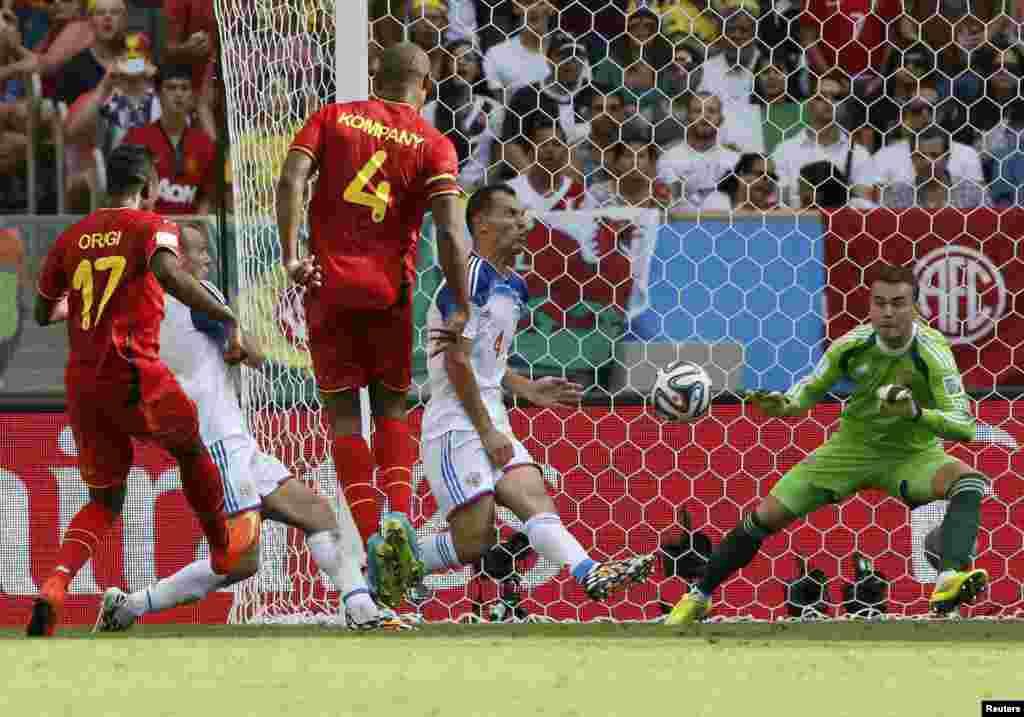 Belgium's Divock Origi scores against Russia during their match at the Maracana stadium in Rio de Janeiro, June 22, 2014.