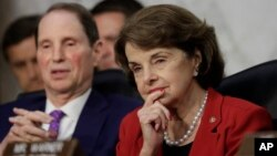 Senate Intelligence Committee member Sen. Dianne Feinstein, D-Calif., right, listens as Attorney General Jeff Sessions testifies on Capitol Hill in Washington, D.C., June 13, 2017.
