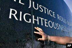 "King's words from the ""I Have a Dream"" speech appear on a wall of the Civil Rights Memorial in Montgomery, Alabama, which is dedicated to those who died in the struggle for equal rights"