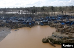 FILE - A view of an illegal gold mining camp in a zone known as Mega 14, in the southern Amazon region of Madre de Dios, July 14, 2015.