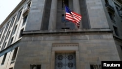 The U.S. Department of Justice headquarters building is seen after Deputy U.S. Attorney General Rod Rosenstein announced grand jury indictments of 12 Russian intelligence officers in special counsel Robert Mueller's Russia investigation in Washington, U…
