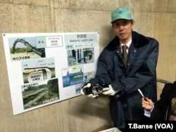 "Kobe City Waterworks Bureau Assistant Manager Hitoshi Araike holds a ""seismic resistant joint"" for water pipes, which is now being deployed in Kobe's system."