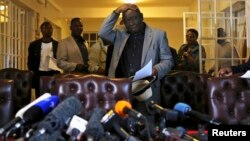 FILE: Zimbabwe's Prime Minister Morgan Tsvangirai gestures during a news conference, Harare, Aug. 3, 2013.