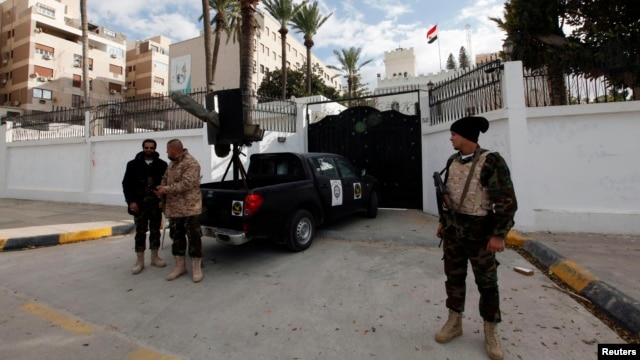 A general view of security in front of the Egyptian embassy in Tripoli, Jan. 25, 2014.