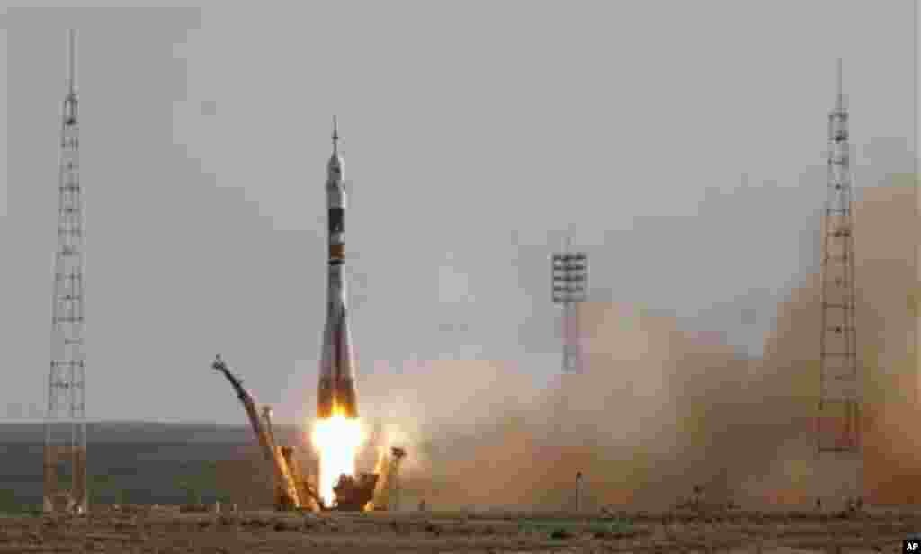 The Soyuz-FG rocket booster with a Soyuz TMA-04M spaceship carrying a new crew to the International Space Station, ISS, blasts off from the Russian leased Baikonur cosmodrome, in Kazakhstan, Tuesday, May 15, 2012. The Russian rocket is carrying U.S. astro