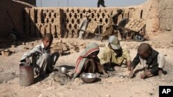 Afghan children work at a local brick factory in Jalalabad, Nangarhar province, Afghanistan, October 8, 2012.