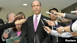 U.S. Ambassador to Japan John Roos (C) delivers a statement after a meeting with Japan's Senior Vice Foreign Minister Shuji Kira (not in picture) at the Foreign Ministry in Tokyo, in this photo by Kyodo October 17, 2012.