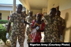 FILE - The rescued Chibok school girl, Amina Ali, was airlifted by Nigeria Air Force from Damboa to Maiduguri alongside her baby and supposed husband.