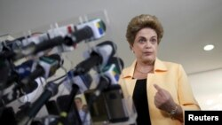 FILE - President Dilma Rousseff addresses a news conference in Brasilia, Brazil, April 5, 2016.