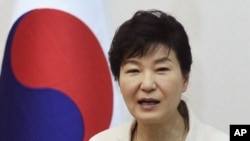 South Korean President Park Geun-hye speaks during a luncheon meeting with members of charity groups at presidential house in Seoul, South Korea, Thursday, Aug. 20, 2015.