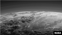 FILE - An image of Pluto's surface captured by NASA's New Horizons spacecraft. The new thinking about volcanoes raises questions about how the tiny, distant world has been so geologically active.
