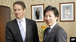 U.S. Treasury Secretary Timothy Geithner, left, shakes hands with his Japanese counterpart Jun Azumi prior to their meeting in Tokyo, January 12, 2012.