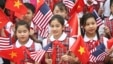 Vietnamese students hold U.S. and Vietnamese flags at a welcoming ceremony for U.S. President Barack Obama at the Presidential Palace in Hanoi, Vietnam, May 23, 2016.