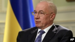FILE - Ukraine's Prime Minister Mykola Azarov speaks during an interview in Kyiv, Ukraine, June 20, 2012.