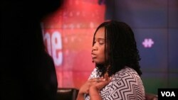 """Morenike Giwa Onaiwu of the Autism Women's Network clasps a """"stimming"""" device while on the panel. (B. Workinger/VOA)"""