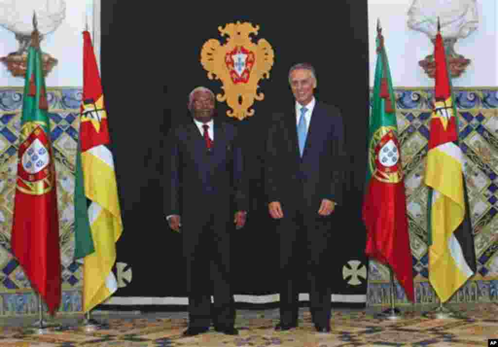 Mozambique's President Armando Guebuza, left, poses for a photograph with his Portuguese counterpart Anibal Cavaco Silva Monday, Nov. 28, 2011 at the Belem presidential palace in Lisbon. Guebuza arrived to Portugal for a two-days official visit. (AP Photo