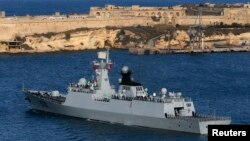 The Chinese Navy frigate Huangshan leaves Valletta's Grand Harbour March 30, 2013, after concluding an anti-piracy mission in the Gulf of Aden, providing security escort to civilian and commercial vessels.