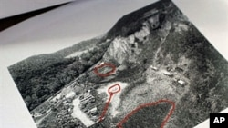 A handout aerial photo of a mass grave released during a press conference in Belgrade, 10 May 2010