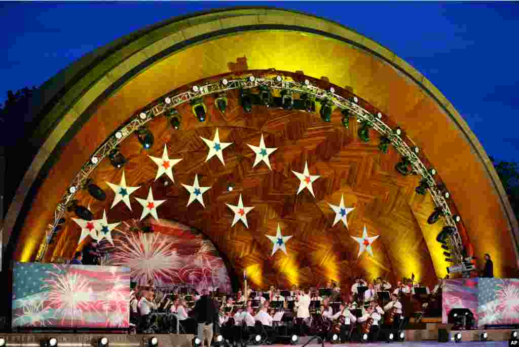 The Boston Pops Orchestra performs during rehearsal for their Fourth of July concert at the Hatch Shell on the Esplanade in Boston, July 3, 2012.