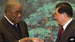 FILE - Zambian President Rupiah Banda, left, toasts with Chinese President Hu Jintao after a signing ceremony for a wide range of mining, trade and cultural agreements, at the Great Hall of the People in Beijing, China, Feb. 25, 2010.