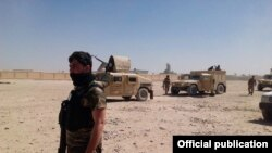 عکسی که از سوی دفتر مطبوعاتی ولایت هلمند نشر شده، سربازان افغان را در حومۀ لشکرگاه نشان میدهد
