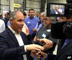 FILE - EPA Administrator Scott Pruitt talks to a reporter after speaking at Whayne Supply in Hazard, Kentucky, Oct. 9, 2017. Pruitt says the Trump administration will abandon the Obama-era Clean Power Plan, aimed at reducing global warming.