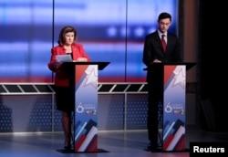 Republican candidate Karen Handel, left, and Democratic candidate Jon Ossoff prepare for Georgia's 6th Congressional District special election debate at WSB-TV studios in Atlanta, Ga., June 6, 2017.