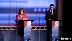 کرن هندل کاندیدای جمهوریخواه (چپ) و جان اوسوف کاندیدای دمکرات (راست)