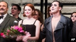 "Emma Stone and Alan Cumming appear at the curtain call following Stone's debut performance in Broadway's ""Cabaret,"" Nov. 11, 2014 in New York."