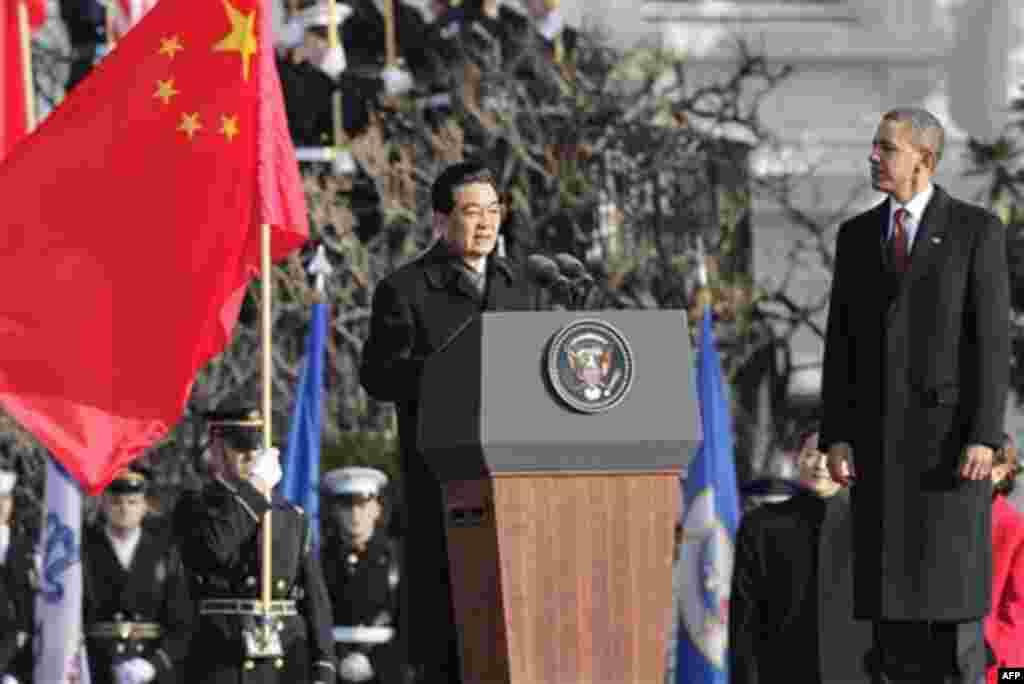 President Barack Obama welcomes China's President Hu Jintao, Wednesday, Jan. 19, 2011, during a state arrival ceremony at the White House in Washington. (AP Photo/J. Scott Applewhite)