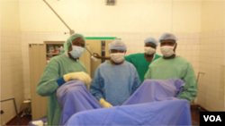 Doctors confer before they begin surgery, Yaounde, Cameroon, June, 2014. (Moki Edwin Kindzeka/VOA)